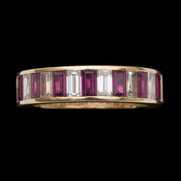 Art deco 18ct gold hoop ring set with alternating diamonds and rubies. Marked Garrard