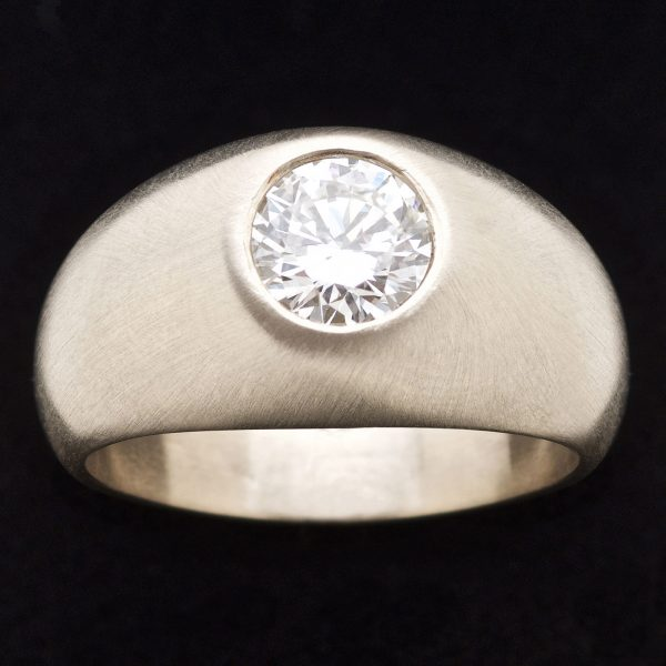 Heavy 18ct burnished white gold ring set with a brillaint cut diamond 1.29ct K/VVS2