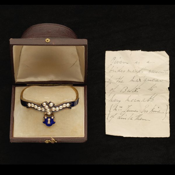 Victorian 18ct gold hinged bangle decorated with dark blue enamel and set 15 natural pearls. Original fitted case a note inside the lid 'Given as a Bridesmaid's present by the Marquess of Bute to Mary MacNabb (Mrs james Erskine of Linlathen)'