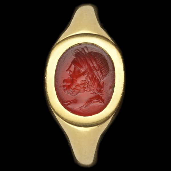 Ancient Roman cornelian intaglio, carved with a draped bust of Jupiter with a full beard, a laurel wreath in his hair c.1st century AD