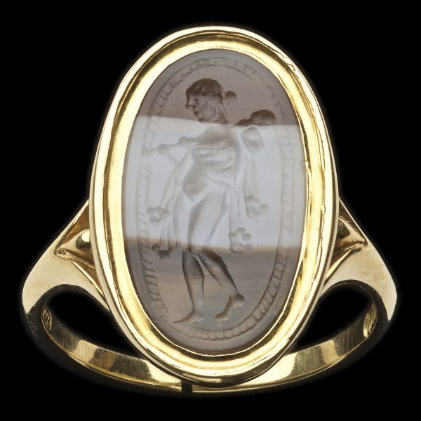 Ancient banded agate intaglio 2nd to 1st century BC. Omphale walking to the right with Hercules' lion's pelt and club over her shoulder, in corded border. Later ring setting