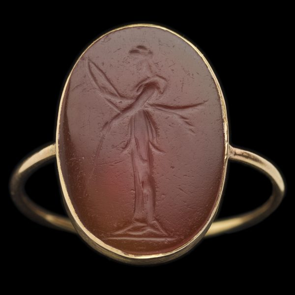 Roman cornelian intaglio carved with a standing figure of Diana, goddess of the hunt, wearing a short peplos and holding a bow and arrow, in a late 18th century fine gold mount .1st century BC