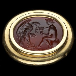 Neo classical carved cornelian intaglio, with a scene depicting Hebe feeding an eagle (Jupiter) from a cup, in an 18ct gold brooch setting c.1800