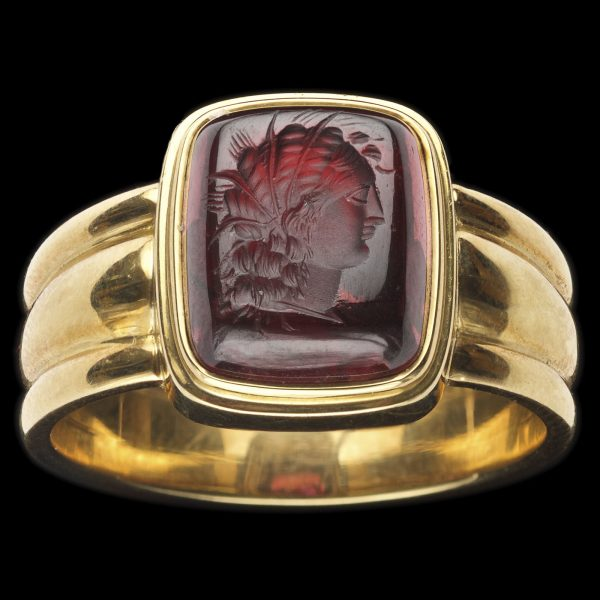 Neo classical garnet intaglio ring, carved with the profile head of Minerva. 18ct ribbed gold setting by Tony White, Sydney