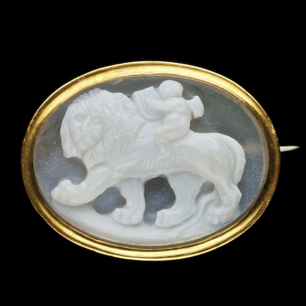 Regency gold brooch set with a sardonyx cameo carved with a figure of Eros on a lion's back symbolising the strength of love