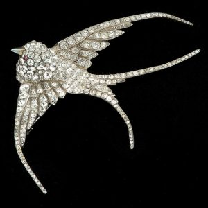 Edwardian swallow brooch. Silver set with pastes. Original fitted case