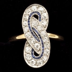 Art Deco diamond and calibre sapphire Love Knot ring 18ct yellow gold and platinum setting