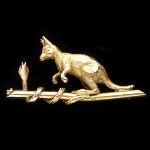 Australian 9ct gold brooch with a kangaroo watching a snake on a log