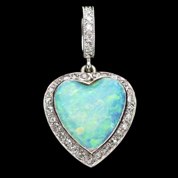 Opal and diamond heart pendant with diamond suspension loop