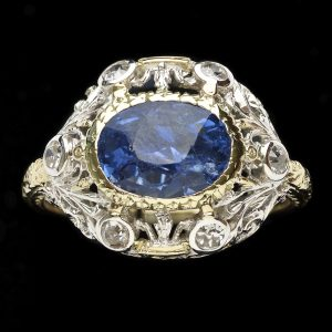 Arts and Crafts ring set with a dark blue Sri Lankan sapphire 3ct in a fine gold and silver mount