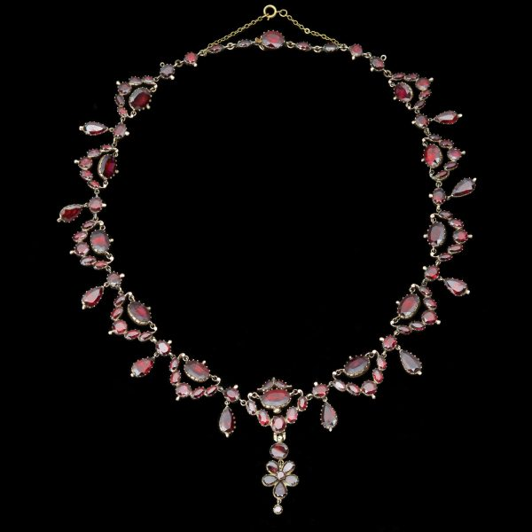Georgian gold necklace set with garnets in closed back settings with detatchable pendant