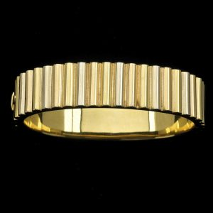 Art Deco three coloured gold ribbed bangle 42.9gm