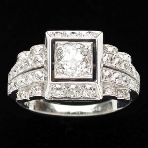 Art Deco style platinum diamond ring set with a central diamond 0.72ct
