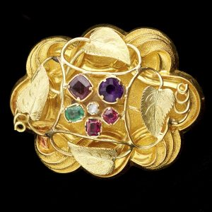Early Victorian 18ct gold 'acrostic' brooch, the initial letters of the gemstones spelling the word REGARD. Original fitted case
