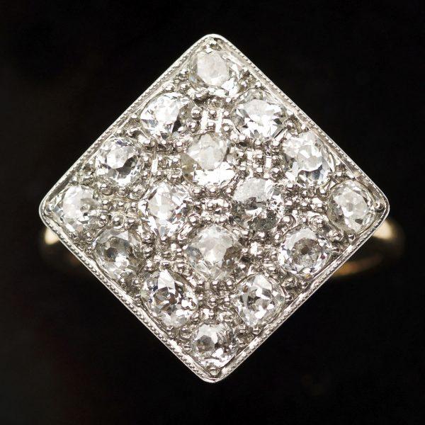 Diamond shaped diamond ring set with 16 diamonds