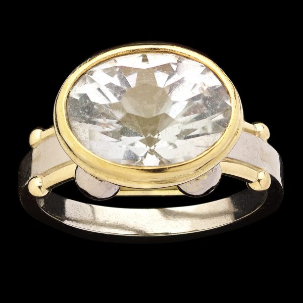 Contemporary 18ct yellow and 9ct white gold ring set with an oval white topaz (Killiecrankie diamond) by Len Mason
