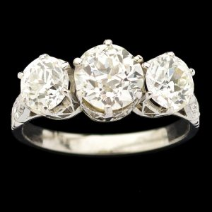 Classic platinum three stone diamond ring
