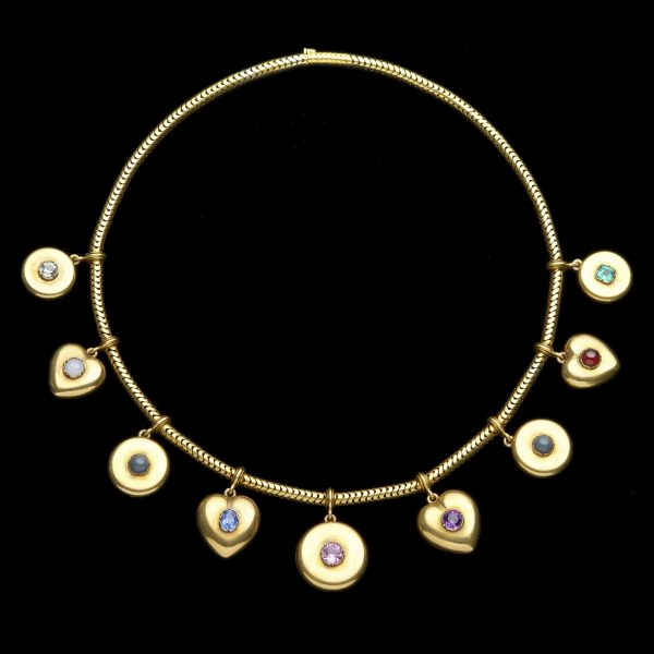 Victorian 18ct gold necklace with five round and four heart-shaped pendants each set with a central gemstone, the initial letters of each spelling the name 'Constance': citrine, opal, nephrite, sapphire, tourmaline, amethyst, nephrite, cabochon garnet and emerald.