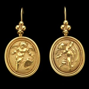 18ct gold oval earrings with repoussé design of cherubs playing with garlands. To the reverse applied signature of Robert Phillips London c.1860