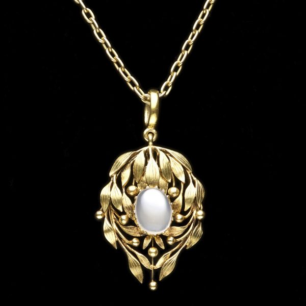 Art Nouveau gold pendant necklace, with laurel leaf design set with a central moonstone c.1895. In original fitted case marked Mrs Newman