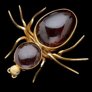 Antique 15ct gold spider brooch set with cabochon garnets c.1890