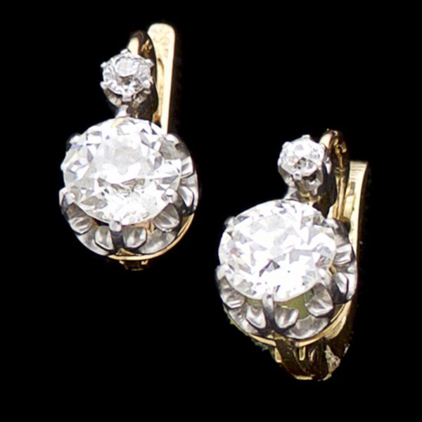 Edwardian single stone diamond earrings total 1.6ct. 18ct gold and platinum settings