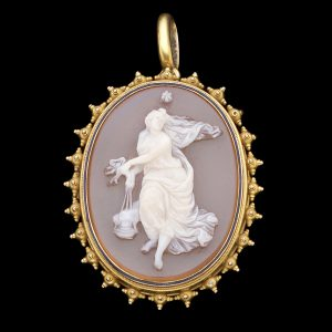 Antique 18ct gold pendant, set with a sardonyx cameo carved with a figure of Vesta holding the eternal flame, original case dated 1884