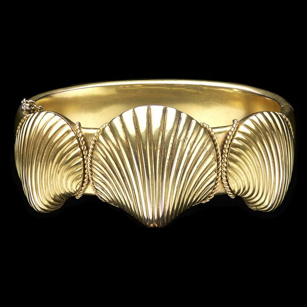 19th Century gold locket bangle in the design of scallops