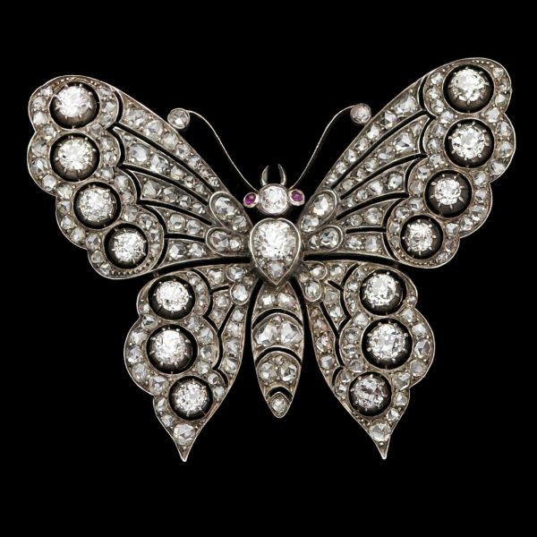 Important Victorian diamond butterfly brooch, the head set with a .50ct diamond and with ruby eyes, the wings and body diamonds total 4.6ct , detachable brooch fitting for use as a pendant c.1880