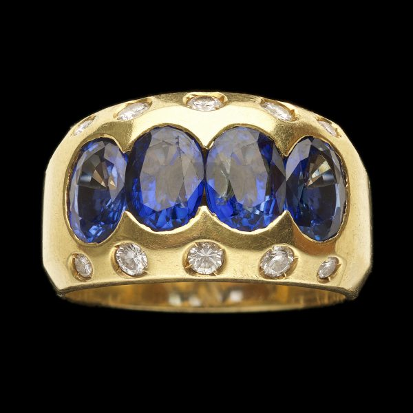 Heavy 18ct gold hoop ring set with four oval deep blue natural sapphires (total 3.6ct) with five small diamonds set along either side