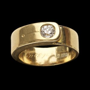 18ct gold ring in the form of a belt, set with a single diamond 0.20ct English, engraved inside the shank 1886