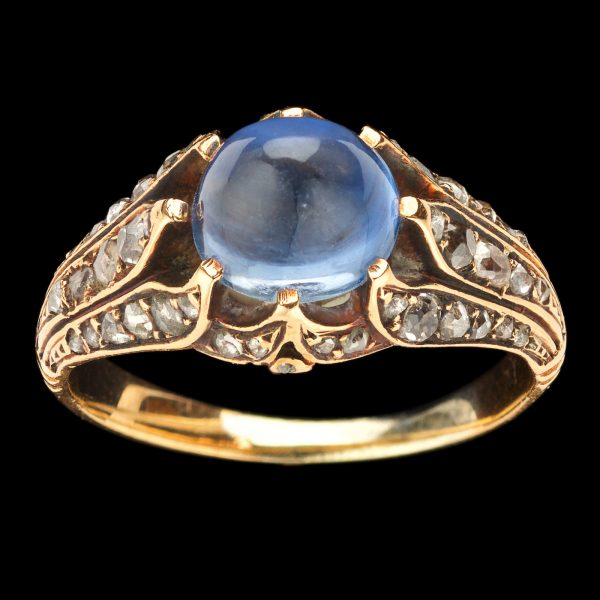Exquisite sapphire and diamond ring, the cabochon cut, pale sapphire in a finely wrought gold coronet setting