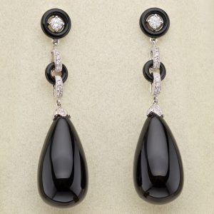Art Deco style onyx and diamond earrings, the onyx pendants suspended from diamond and onyx links