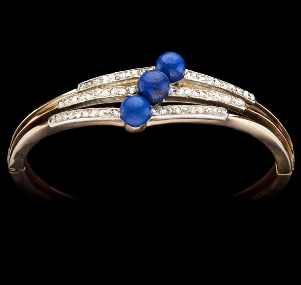 Victorian hinged gold bangle with three rows of small diamonds and three lapis lazuli beads