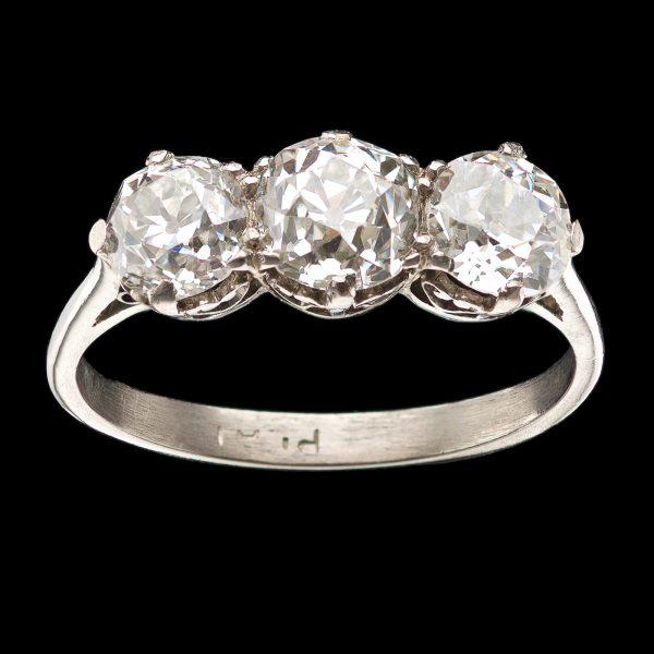 Art Deco three stone diamond ring. The central diamond is 0.85ct, the two side diamonds equal 1.20ct. Platinum setting