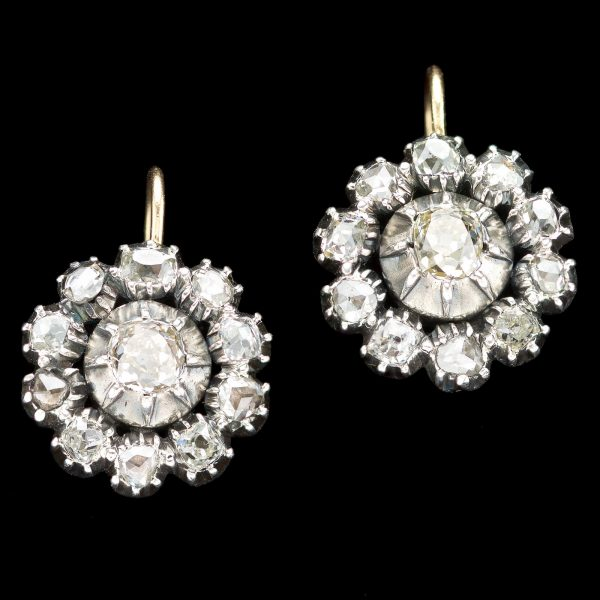 Georgian diamond cluster earrings. Diamonds total 2ct. Silver and gold settings