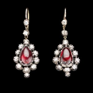 Georgian garnet and diamond earrings. The pear shaped garnets in foiled gold closed back settings, surrounded by diamonds